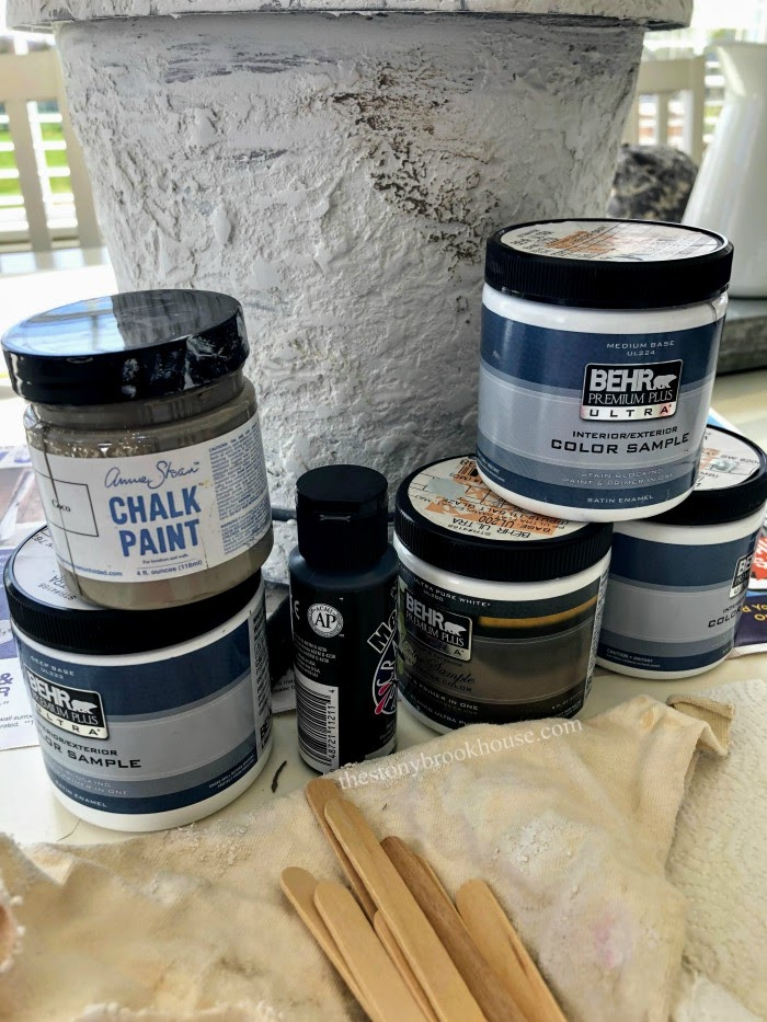 adding paint to concrete pot for character