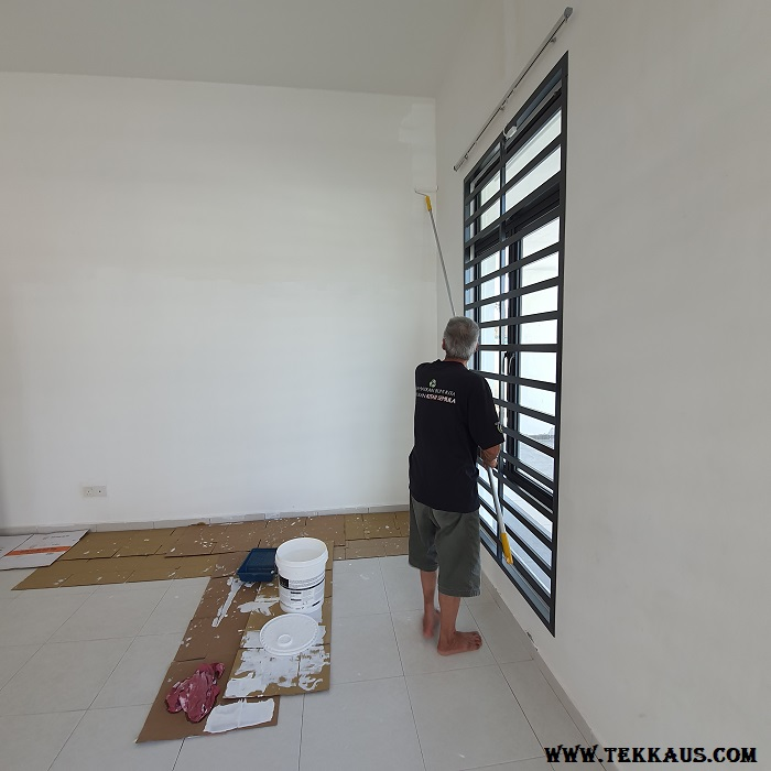 Painting a house with family members