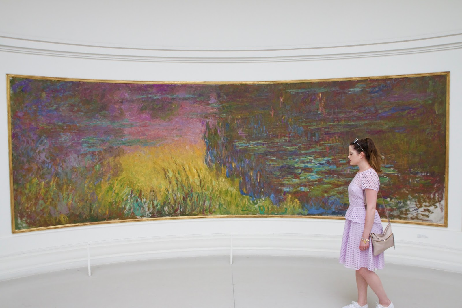 Fashion blogger Kathleen Harper inside the musee de l'orangerie in Paris France