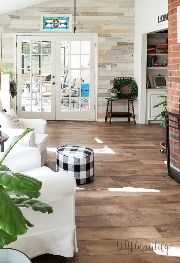 sunroom with farmhouse wood floors
