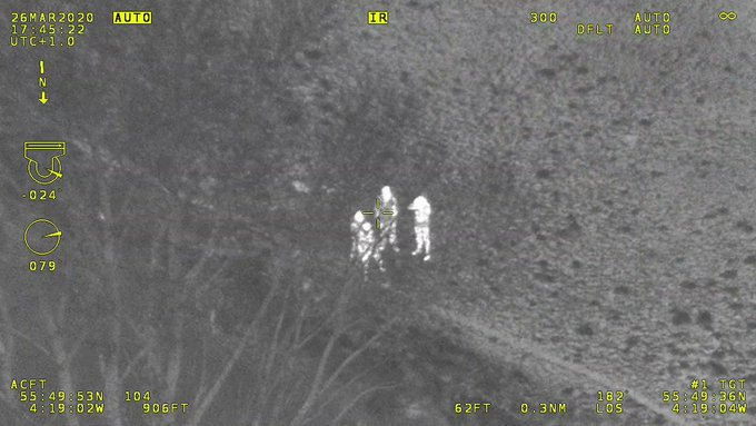 Four people spotted on police helicopter camera, thermal imaging picture of people in a park,