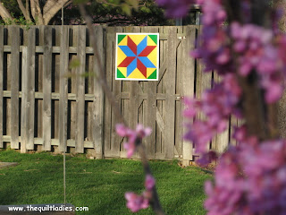 barn quilt on fence