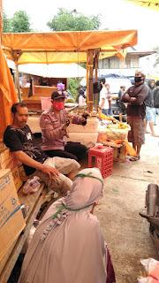 Bhabinkamtibmas Polsek Alla Laksanakan Pengamanan Di Pasar Lo'Ko