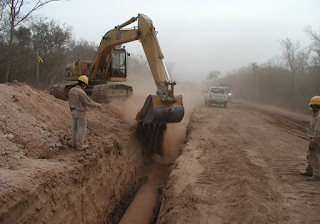 Backfilling with Excavated soil material after the installation of underground pipe