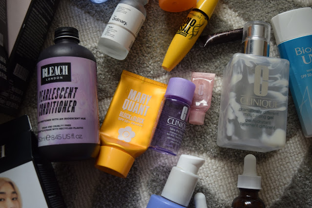 A flatlay of empty beauty products including Bleach London conditioner, Mary Quant sunscreen, Bleach toner and bleach boxes, and skincare from Clinique and The Ordinary