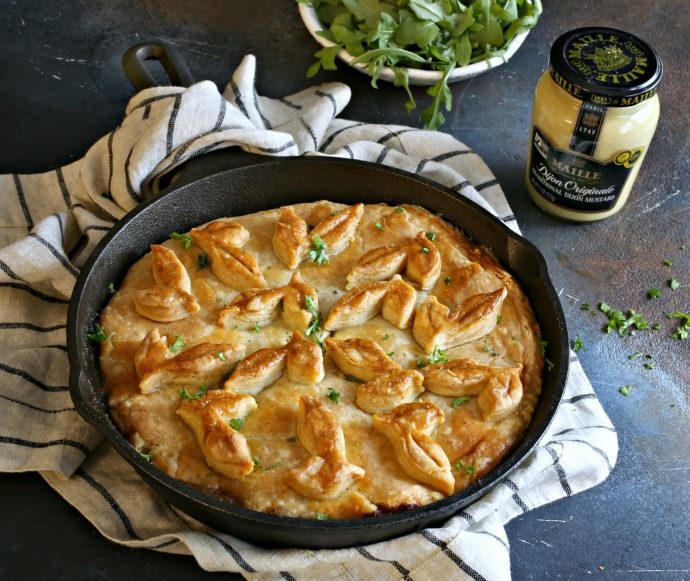 Recipe for a skillet pie with ground beef, mustard sauce and flaky pastry crust.