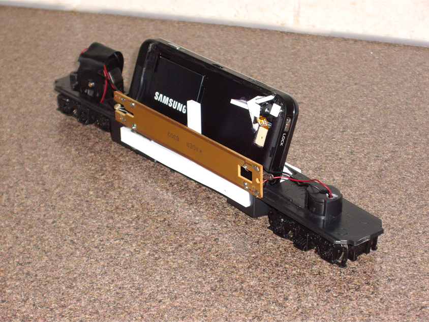 Scratch built model railroad point of view track camera made from a cell phone and old engine