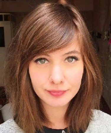 Heavy side-swept bangs
