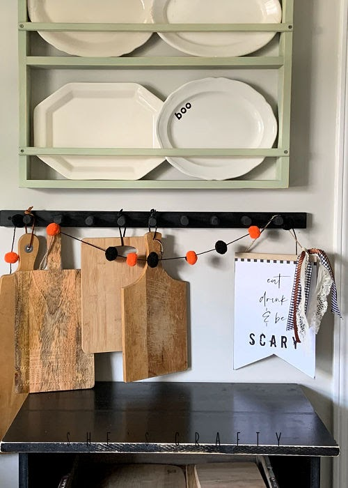 Halloween in the kitchen - Halloween sign made from dollar store sign