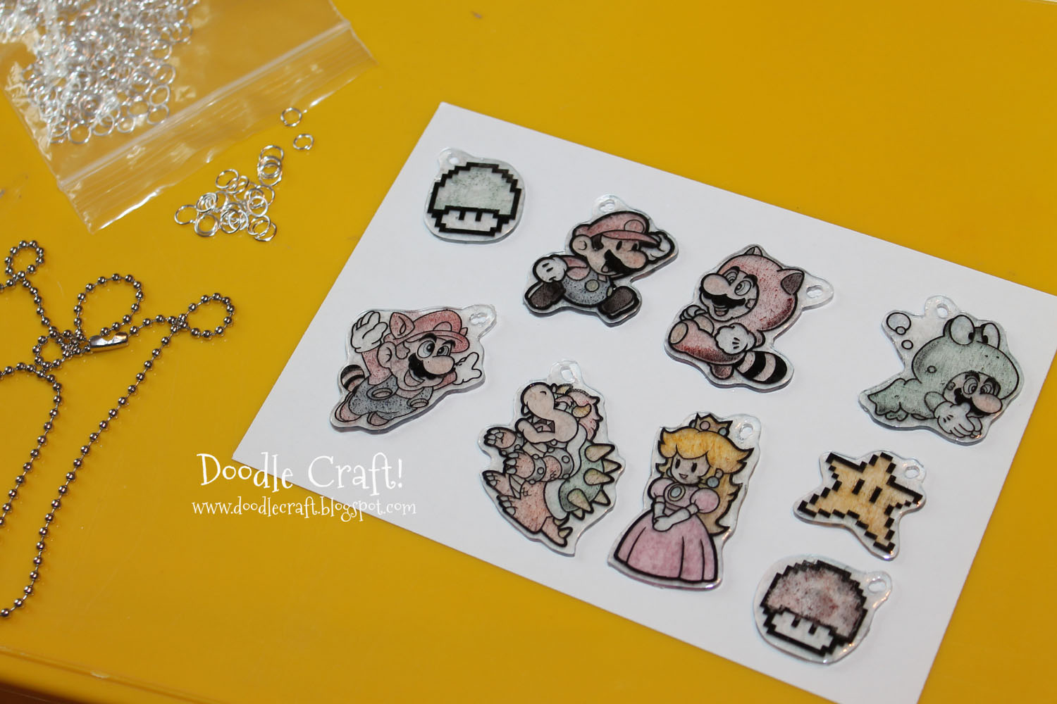 Doodlecraft super mario brothers shrinky dink necklace for Plexiglass arts and crafts