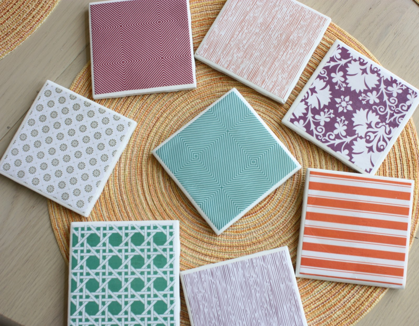 You can make your own coasters for a great deal! I plan to make some  Appalachian coasters for the Man Loft :)