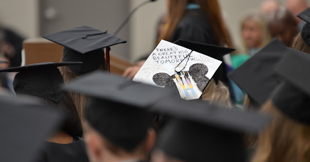 """graduation cap with """"There's a Big Beautiful Tomorrow"""" text"""