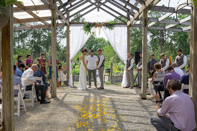 Tropical wedding ceremony at Shadowood Farms wedding in Palm City Florida photo by Houghton Photography