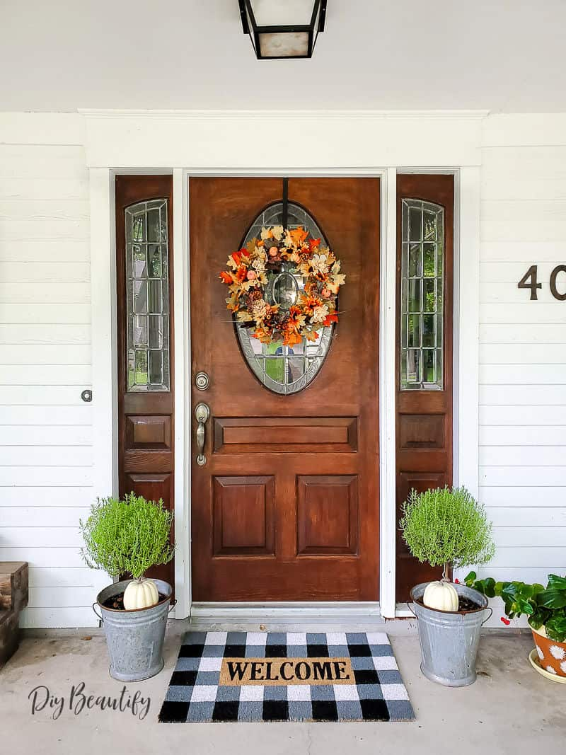 Fall front door with colorful wreath
