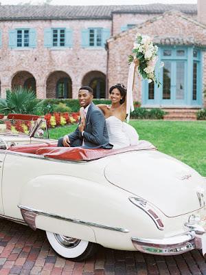 happy bride and groom in vintage car