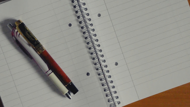 notepad and pencils