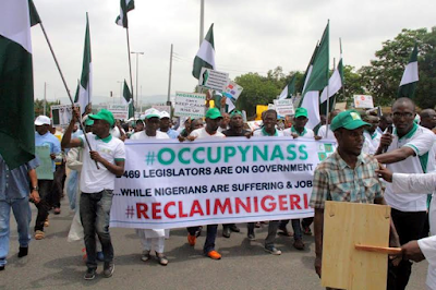 demonstrators in abuja on the streets demanding bukola saraki resigns as senate president