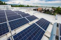 Solar panels on a senior housing facility in Boulder, Colorado. (Credit: Dennis Schroeder / NREL) Click to Enlarge.