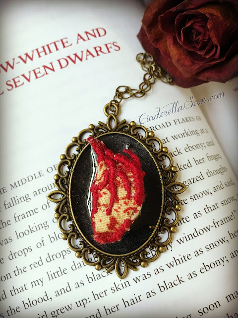 Evil Queen Anatomical Heart Necklace - This wearable textile art is handmade to reflect the Evil Queen's own heart being consumed by dark magic. Inspired by Regina Mills of Once Upon a Time, this one of a kind art necklace is perfect for a fan of macabre art! Click to learn more about the piece and artist who makes it #macabre #evilqueen #reginamills #handmadejewelry #onceuponatime #snowwhite #textileart #fiberart #mixedmedia