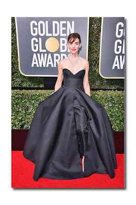54225b358a4 Alison Brie in a strapless black jumpsuit with an over skirt (clean