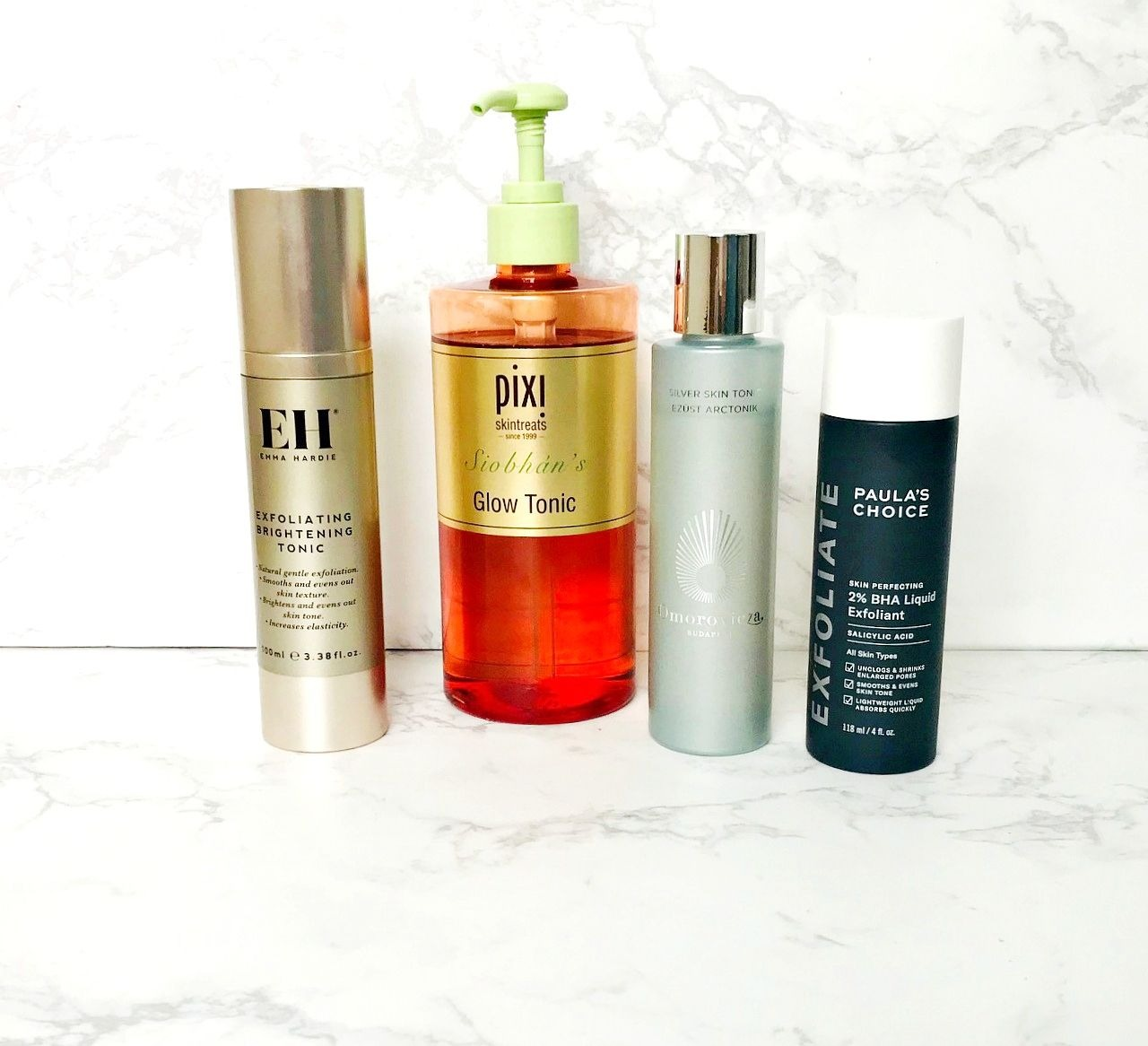 Exfoliating toner, acid toner, Omorovicza Silver Saviour Tonic, Paula's Choice Skin Perfecting 2% BHA Liquid Exfoliant, Emma Hardie Exfoliating Brightening Tonic Review, Pixi Glow Tonic,