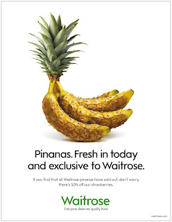An ad with a picture of bananas that have the texture of pineapples.