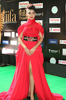 Apoorva in a Stunning Tight Leg Split Sleeveless Red Gown at IIFA Utsavam Awards 008.JPG
