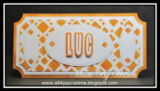 Een bruin-wit naambordje voor onze kleinzoon Luc met bruine vierkantjes en witte ovalen. A brown and white nameplate for our grandson Luc with brown squares and white ovals.