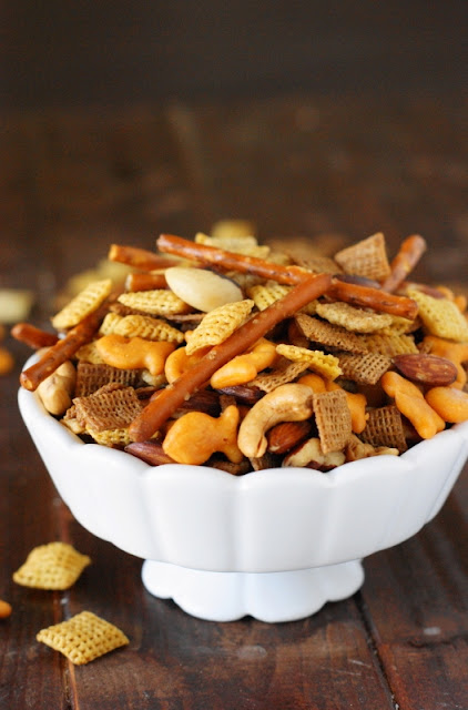 The next time that craving for a salty-crunchy snack hits, skip the grocery story aisle and whip up some classic Homemade Chex Mix yourself!  www.thekitchenismyplayground.com