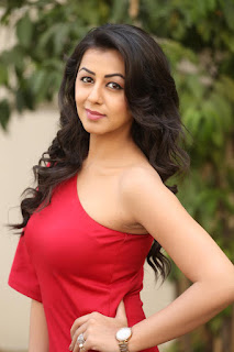 Nikki galrani looks so cute in a half Shoulder red gown wow