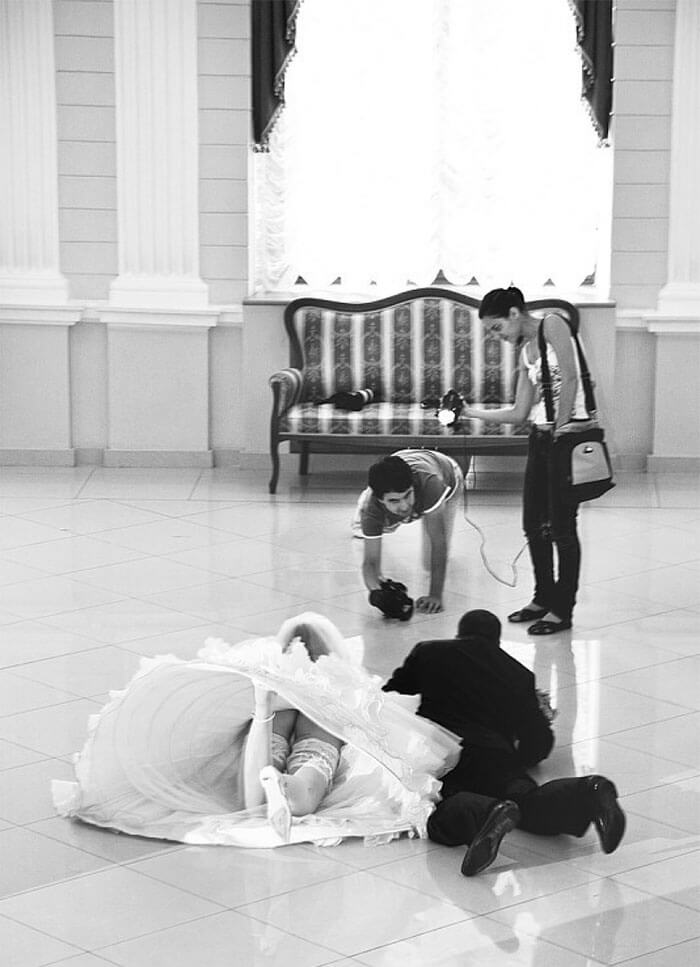 Incredible Wedding Pictures That Show Photographer Will Do Anything To Capture The Perfect Shot