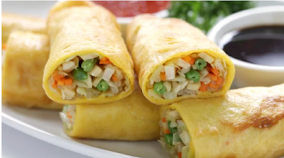Chinese Recipes: Infused with a range of flavors, crisp vegetarian spring rolls with cheese, bell peppers and sun dried tomatoes.