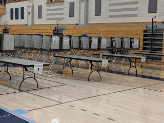 precinct tables are quiet after 8:00 PM when the polls have closed