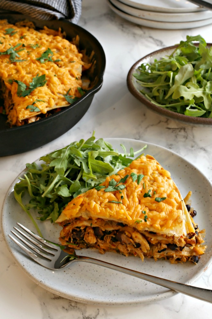 Recipe for a savory skillet pie filled with tortillas, shredded chicken, sauce and cheese.