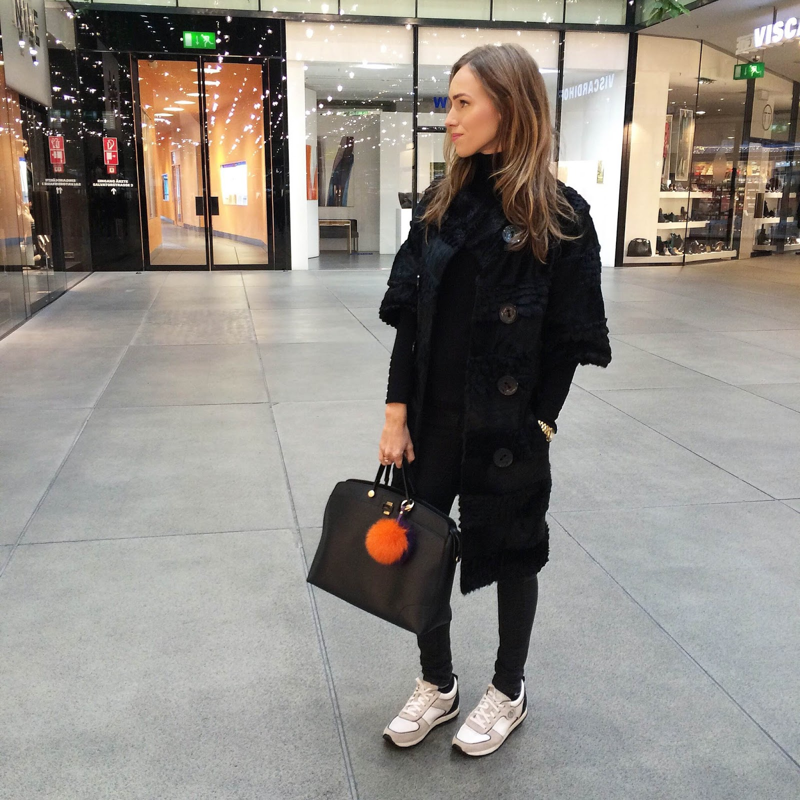kristjaana mere black fur coat black jeans white sneakers winter style outfit