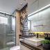 Banheiro cinza e marrom com revestimento 3D e bancada contínua!