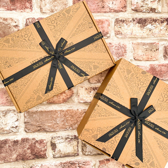 Packaged toys in nice printed cardboard boxes, tied with ribbon