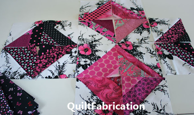 pink black and white half square triangle blocks