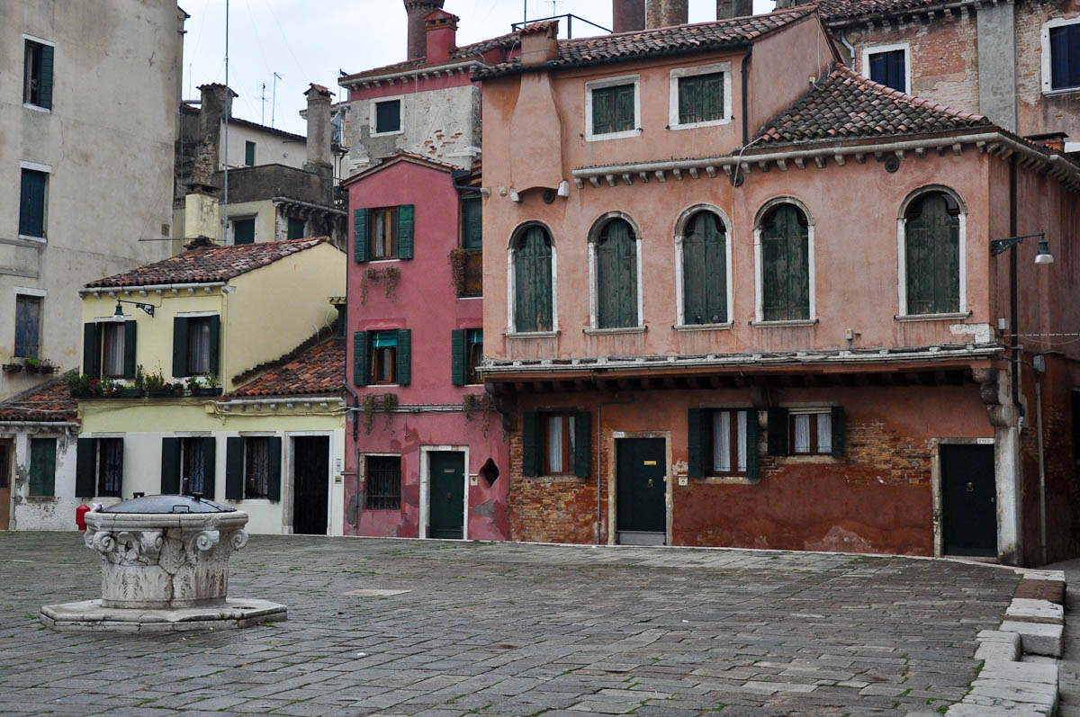 A square with a well and mis-shaped houses, Venice, Italy
