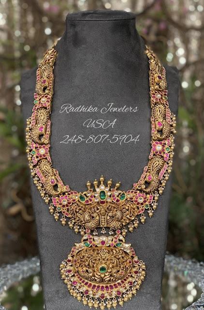 Peacock Nakshi Haram by Radhika Jewellers