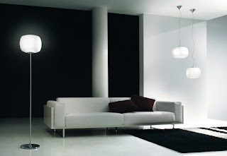 tall floor lamp next to the sofa in white and black interior design