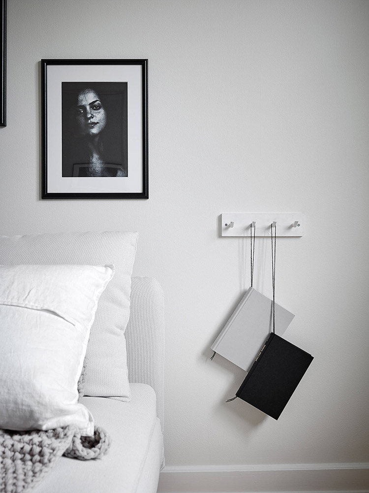 Black and white art on the bedroom wall | Stadshem