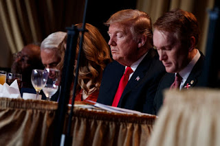 President Trump prays during the National Prayer Breakfast on Feb. 7 in Washington. The prayer breakfast is hosted by a group called the Family, which is portrayed in a new Netflix documentary.