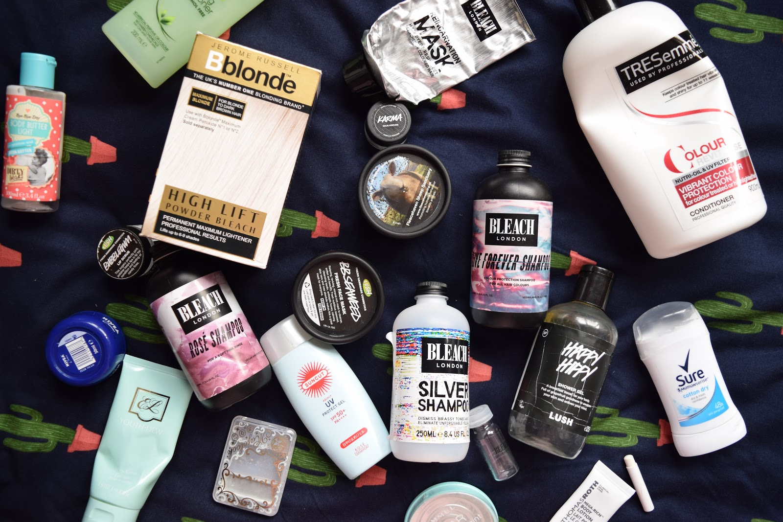 flatlay of empty beauty products including bleach London, Lush, Kosé etc.