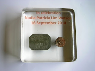 Personalised paperweight containing coins