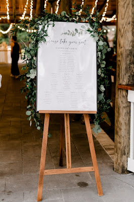 wedding seating sign and greenery