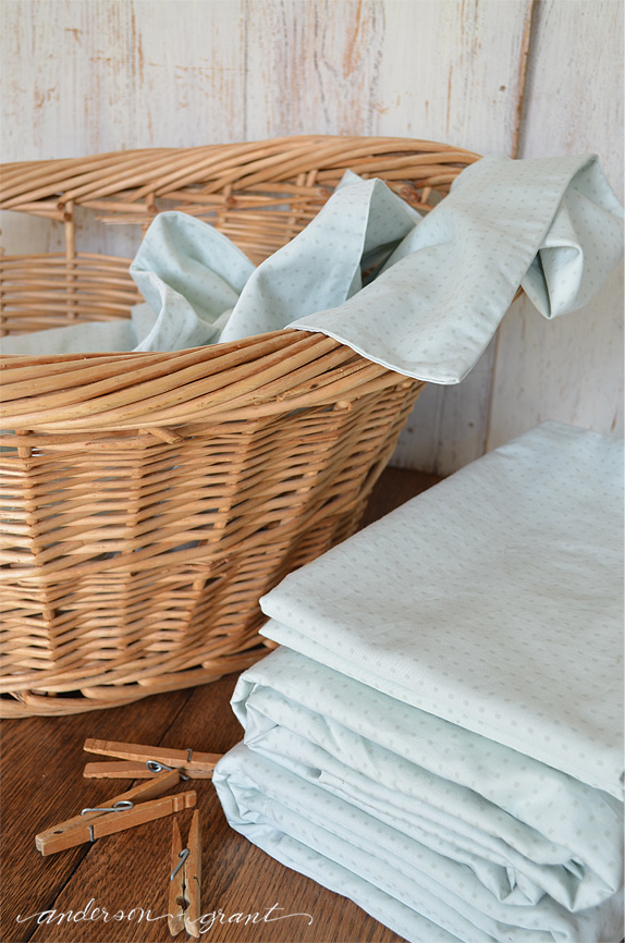 Knowing how to fold a fitted sheet is a simple tip that everyone should know.  |  www.andersonandgrant.com