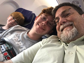 David Brodosi and family on airplane traveling to grand canyon