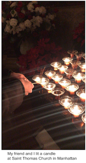 My friend and I lit a candle at St. Thomas Church in Manhattan.