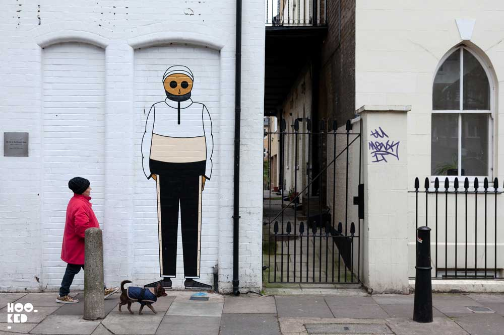 French Street Art Duo Kamlaurene Visit London installing a series of large scale paste-ups in Shoreditch